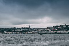 The town of Cobh , which sits on an island in Cork city's harbour, as seen from the sea. It's known as the Titanic's last port of call in 1912 Royalty Free Stock Photos