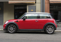 Red Mini Cooper car. TOWN, COUNTRY - CIRCA AUGUST 2017: red Mini Cooper car 2013 model with white roof Stock Images