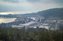 The town of dover port and dark skies. The town also has commerical activities. With shops and car parking stock images
