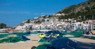Town and fishing nets Stock Images