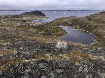Town of Fogo and icebergs, Newfoundland Royalty Free Stock Image