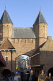 Town gate Kamperbinnenpoort in shopping street Stock Image