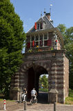 City gate Oosterpoort and bikers, Hoorn Stock Photos