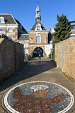 Town gate the Waterpoort and mosaic of Flipje Stock Images