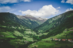 Town in Green Valley Under Clouds and Blue Sky Royalty Free Stock Photo