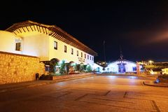 Guatavita, Colombia; 02 03 2019: The town of Guatavita at night, place for the legend of El Dorado and people visiting the tower a. The town of Guatavita at stock photography