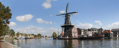 Town of Haarlem, Netherlands. Panoramic shot of the Dutch city Haarlem with the windmill De Adriaan Stock Photo