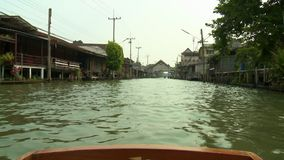 A town half-submerged in the gloomy flood water