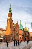 Town Hall building on Wroclaw central market square rynek in Wroclaw. Old historic town with old colourful buildings and tourists at evening royalty free stock photo