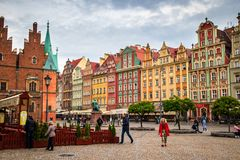 Town Hall building on Wroclaw central market square rynek in Wroclaw. Old historic town with old colourful buildings and tourists at evening stock photos