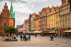 Town Hall building on Wroclaw central market square rynek in Wroclaw. Old historic town with old colourful buildings and tourists at evening royalty free stock image