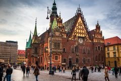 Town Hall building on Wroclaw central market square rynek in Wroclaw. Old historic town with old colourful buildings and tourists at evening stock photography