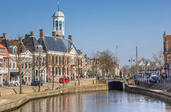 Town hall at a canal in historical Dokkum Stock Photos