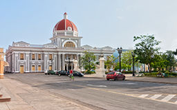 Town hall of Cienfuegos city at Jose Marti park with some locals Royalty Free Stock Photo