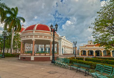 Town hall of Cienfuegos city at Jose Marti park with some locals Stock Photos