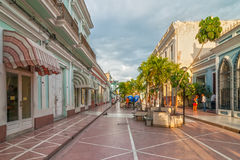 Town hall of Cienfuegos city at Jose Marti park with some locals Royalty Free Stock Photography