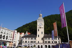 Town hall with Clock tower in Rosa Khutor. Sochi, Russia Stock Photos