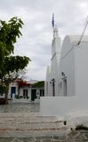 Town hall and flag. Orthodox temple on island of Folegandros, Cyclades, Greece. Town hall on island of Folegandros. Orthodox temple on island of Folegandros Stock Photography