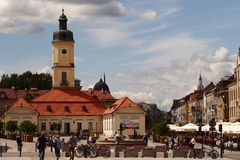 Town hall and the main square in BiaÅ'ystok. A view on a town hall an the main square in Białystok with some restaurant tables and people walking stock photo