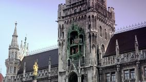 Town hall on the main square Marienplatz in the center of the Munich stock video footage