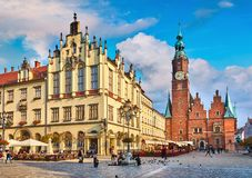 Town hall on market square in Wroclaw. Poland picturesque panorama medieval town with evening blue sky and white cloud Royalty Free Stock Images