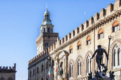 Town hall and Neptune Fountain of Bologna, Italy. Neptune Fountain amd Clock tower of Palazzo d'Accursio, town hall on Square Piazza Maggiore in Bologna, Italy stock image