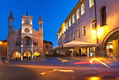 The town hall of Pordenone, the symbol of the city at sunset. Italy. The Gothic Communal Palace (1291–1395) of Pordenone at sunset with street lighting. The Royalty Free Stock Photography