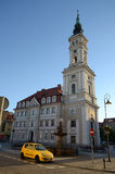 Town Hall in Prudnik. And small yellow car (Poland stock photography