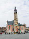 Town Hall of Sint-Truiden, Limburg, Belgium. SINT-TRUIDEN, BELGIUM - APRIL 21, 2013: Unidentified people near the Town Hall at the central market square of Sint stock photo