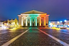 Town Hall Square at night, Vilnius, Lithuania. Town Hall Square in Old Town illuminated by the colors of the national Lithuanian flag at night of Vilnius Stock Photography