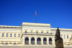 Town hall in Warsaw with polish flag. Town hall in Warsaw on the blue sky Stock Photos