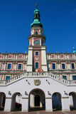 Town Hall in Zamosc. Zamosc, Poland - August 11, 2013: Town Hall located at main Market Square with blue sky in background Stock Photography