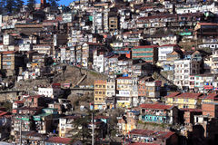 Town on the hillside. The image is of hillside view of the town of Shimla in India. Shimla is located in the lower himalayas in India and is the capital of the Stock Photo