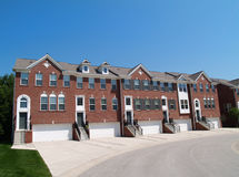 Town Homes With the Garage in the Front. Red brick condos or town homes with the garage in the front Royalty Free Stock Photos