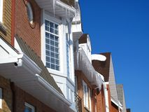 Town homes with icicles Stock Images