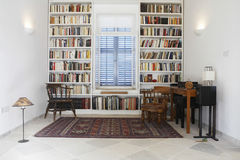 Town House With Books Arranged In Library. Interior of town house with books arranged in library stock images