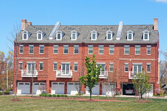 Town House. Brick Town house with apartments and garage doors Royalty Free Stock Photography
