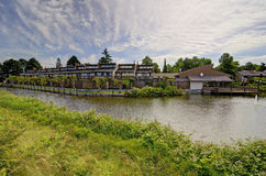 Town house condo flats by a pond Royalty Free Stock Image