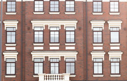 Town house in a flat style with square windows Stock Photos