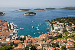 Town of Hvar, Croatia. Beautiful view Hvar town with red roofs and blue Adriatic sea, Croatia Stock Image