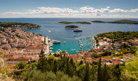 Town of Hvar yacht harbor. Aerial view of Hvar rooftops and harbor, Dalmatia, Croatia Royalty Free Stock Images