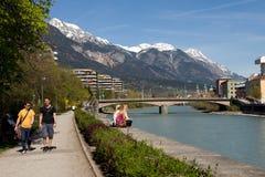 Town innsbruck and river inn, austria. Pedestrian walkway on the bank of the river Inn in Innsbruck Royalty Free Stock Images