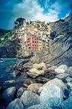 Town In Italian Riviera. Retro Filtered Photo Of Riomaggiore Harbor In The Italian Riviera Stock Photo