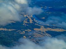 Town of Jasper through the clouds. From a mountain, Jasper National Park, Alberta, Canada Stock Photography