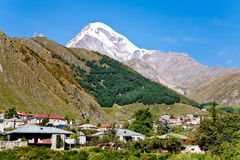 Town Kazbegi and Mount Kazbek in Georgia Stock Photography