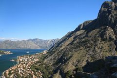 The town of Kotor at the foot of the majestic mountains Stock Photo