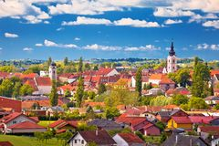 Town of Krizevci cloudy skyline and green landscape view royalty free stock photo