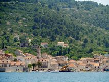 The town Kut on the isle Vis. View of the village Kut at the waterfront of the bay of Vis on the island Vis in the Adriatic sea of Croatia Stock Images