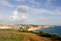 Town of Lagos in Portugal. The town of Lagos in the Algarve, Portugal, shot from the clifftops, with the coastline also visible Royalty Free Stock Photo