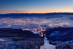 Town Liberec with winter mountain forest before sunrise. Czech early morning snow landscape pink and violet light. Snowy trees wit. H town stock images
